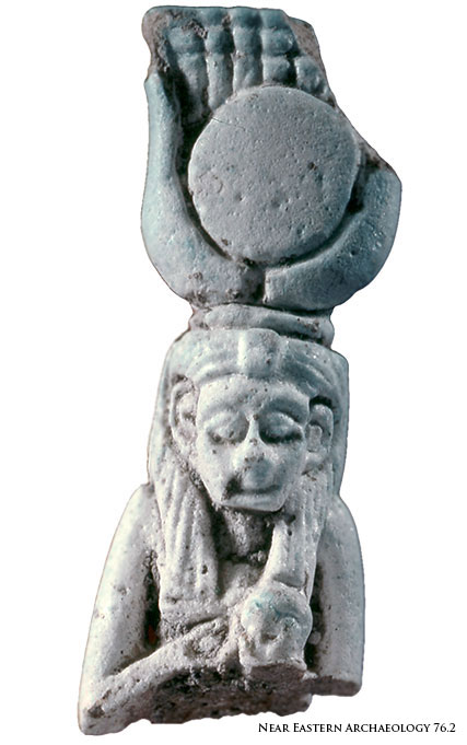 NEA Figure 84: Amulet depicting Isis nursing the god Horus.