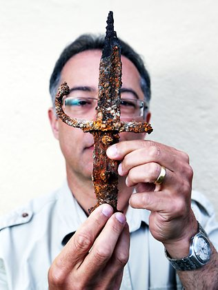 Professor Tony Sagona holding remains of an Ottman sword found during the JHAS survey.