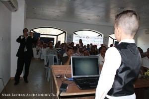 Figure 6. Past, present and future: one of the student participants from the field days gives a presentation at Azraq Heritage Day in 2010.