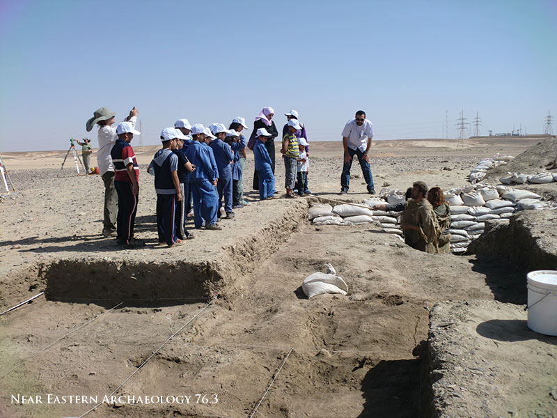 "Figure 9. Accessibility: school children from Azraq visit Kharaneh IV for the first time, and learn about prehistory from archaeologists dressed as ""ancient Kharanehans."""