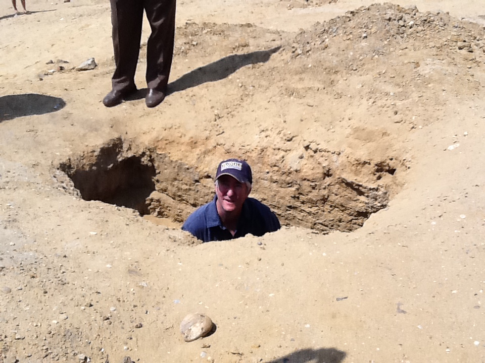 Fig. 2: Eric Cline in looter's pit. Copyright Peter Herdrich