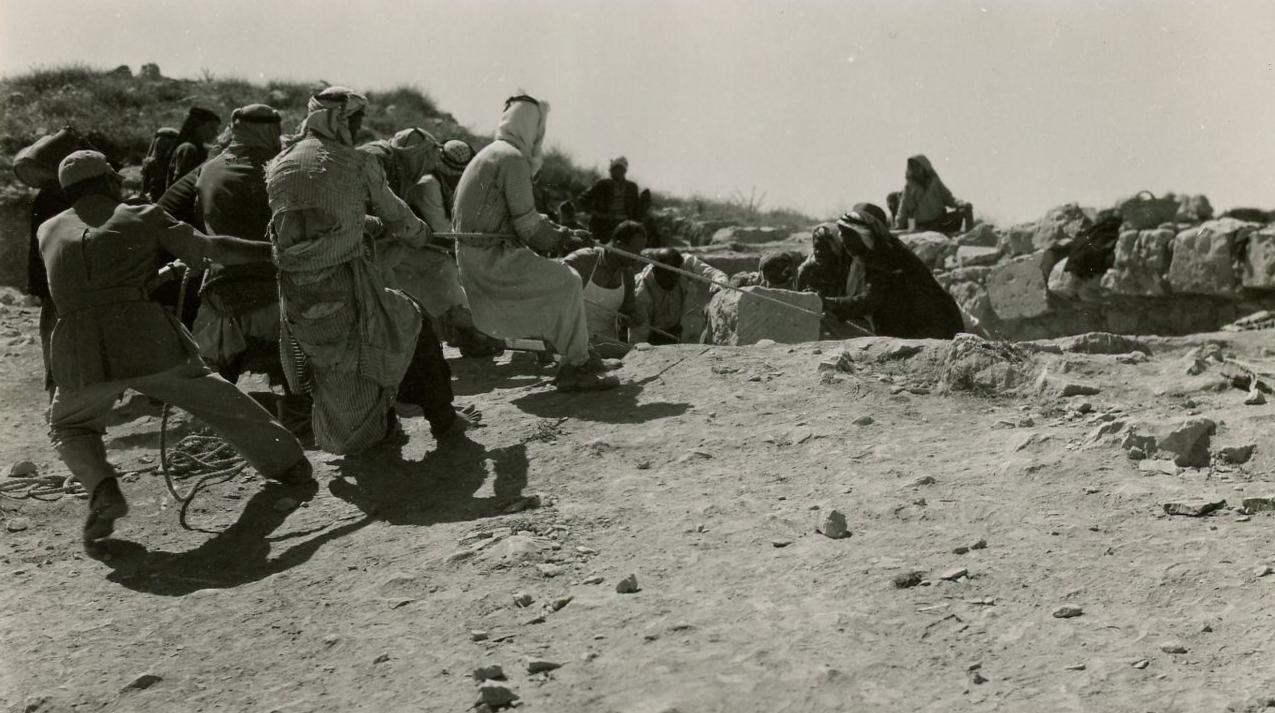 A Nabataean temple was discovered at the Dibon site in 1952. Here, workers remove part of a wall.