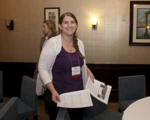 Aviva Cormier setting up for the Women's Initiative Luncheon at the 2013 ASOR Annual Meeting.