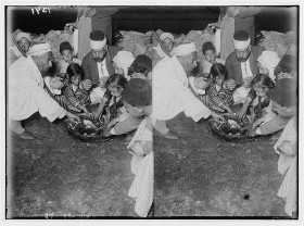 Samaritan family sharing Passover sacrifice, ca. 1900-1920, Matson Collection, Library of Congress.