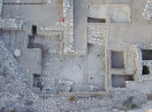 Figure 4. Remains of the Great Temple in Area J after the 2008 season. South is at the top of the photograph, basalt tables are at center, and the altar is at center left.  Compare with figure 5. Photograph courtesy of the Megiddo Expedition.