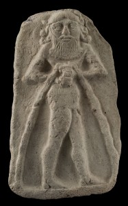 Mould-made clay relief depicting nude mythical figure, Old Babylonian period. © The Trustees of the British Museum.