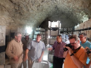 Picture of me (orange shirt) photographing artifacts in Karak Castle.