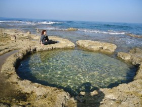 Rock cut pool for keeping murex shells intended for the purple dye industry in Shiqmona (E.G.).