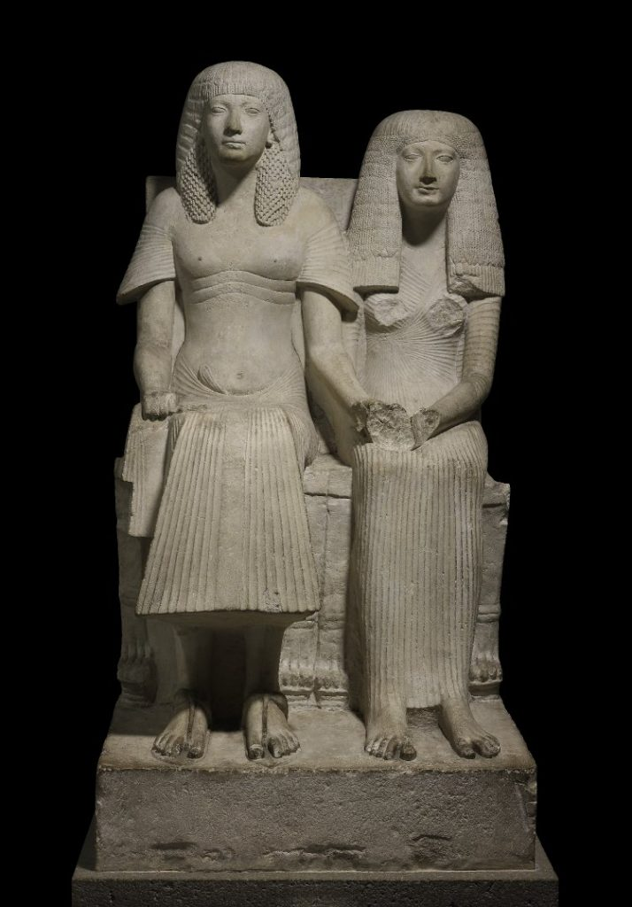 Limestone statue of Horemheb and one of his wives. (British Museum)