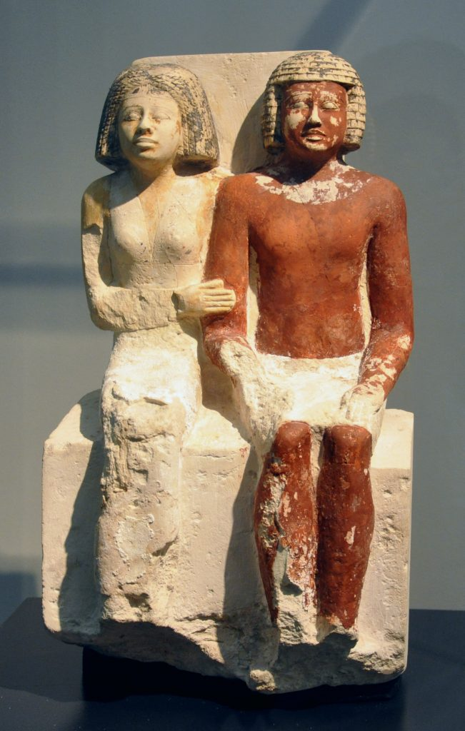 Limestone statue of a seated couple from the 5th Dynasty. (Wiki Commons)