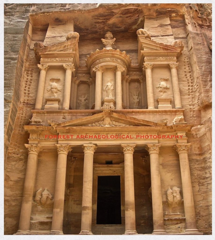 Image courtesy of Brandy Forrest One of the most frequently photographed sites at Petra, the treasury is not just about the building itself, but also the workers who built it. The eye of an archaeologist and photographer notes the placement of the small footholds used by the workers over 2000 years ago to build the ancient city of Petra, which are clearly evident in this image.
